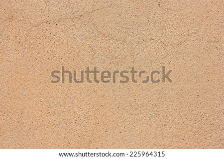 Yellow cement floor with a crack and saw the sand. - stock photo
