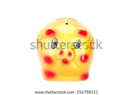 Yellow ceramic piggy bank isolated on white background - stock photo