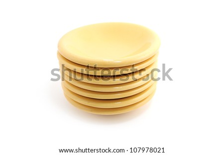 Yellow Ceramic Sauce Plate isolated on white