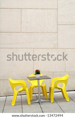 Yellow chairs in a street cafe - stock photo