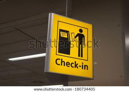Yellow check in information sign on a airport. - stock photo