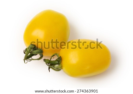 yellow cherry tomatoes on white background - stock photo