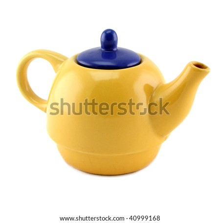 Yellow china teapot with a blue lid isolated.