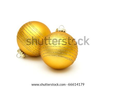 yellow christmas balls on white - stock photo