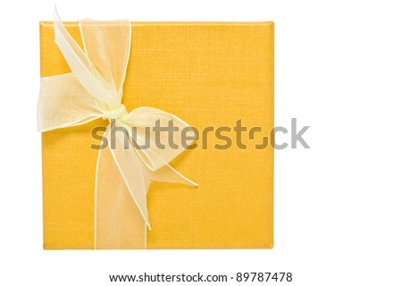 Yellow Christmas gifts box with white bow. Isolated on white