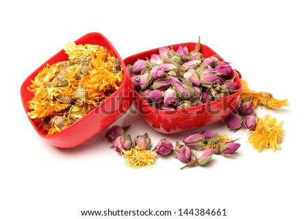 Yellow chrysanthemum flower tea and tea rose flowers on white background