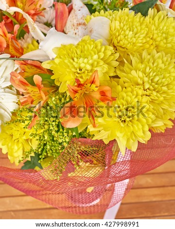 yellow chrysanthemums and orange freesias bunch closeup