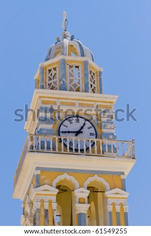 Yellow Church Tower in Santorini, Greece - stock photo
