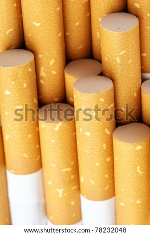 Yellow cigarette filters close-up - stock photo