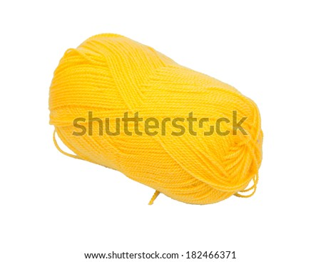 Yellow clew wool isolated on a white background