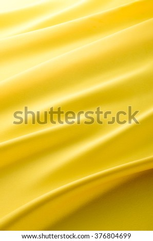 Yellow cloth drape - stock photo