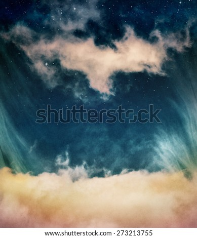 Yellow clouds and fog looking up into a fantasy night sky with stars.  Image has a distinct and pleasing paper grain and texture when viewed at 100 percent. - stock photo
