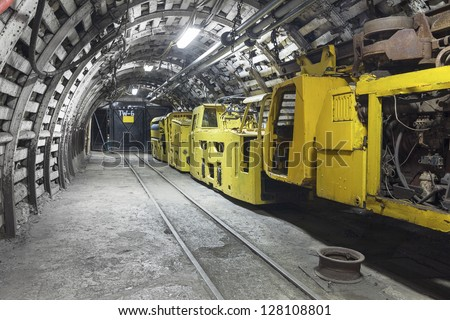 Yellow coal mine transporter - stock photo