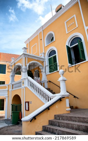 Yellow colonial style house in Willemstad, Curacao in the Caribbean - stock photo