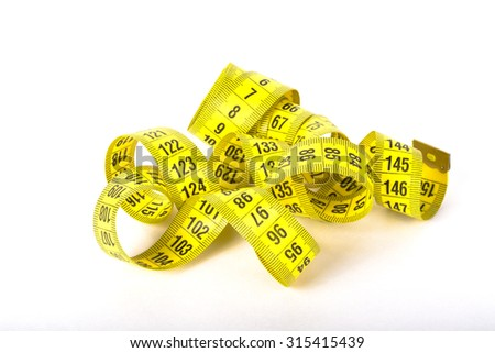 Yellow color centimeter with black figures for measurement of length and width on a white background.