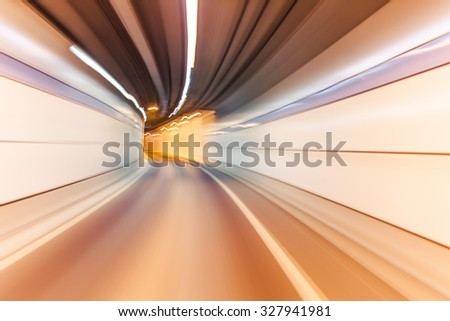 yellow color tunnel car driving motion blur - stock photo