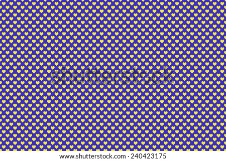Yellow Colored Heart Shape with blue background - stock photo