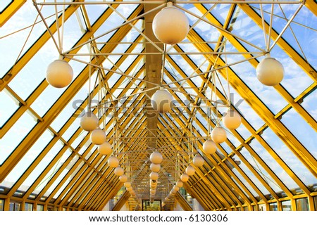 yellow construct with spheres and blue sky - stock photo