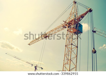 Yellow construction crane over the sky.