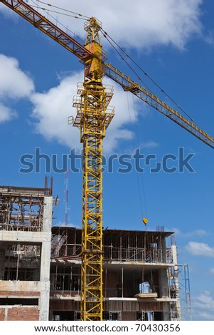yellow construction crane with intense blue sky on a sunny day