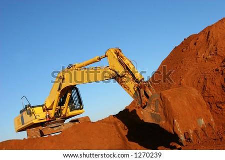 Yellow construction vehicle working - stock photo