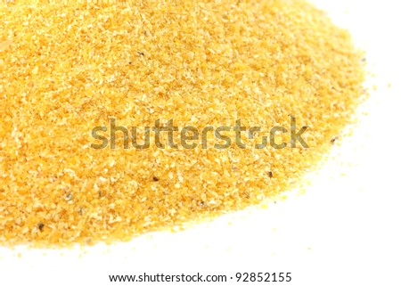 Yellow corn flour scattered on white background - stock photo