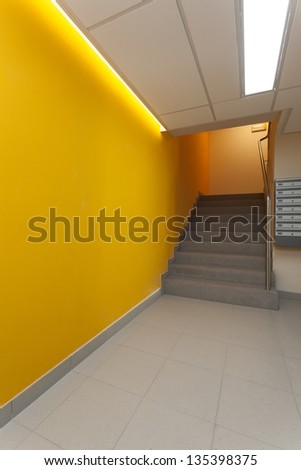 Yellow corridor of modern apartment - stock photo