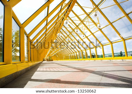 Yellow corridor, spheres and people motion - stock photo