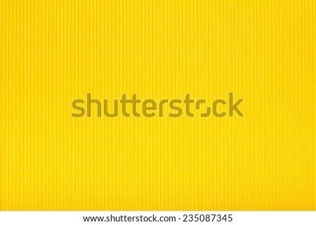 Yellow corrugated cardboard carton in a  colorful texture background series. - stock photo