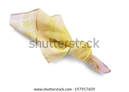 Yellow cotton handkerchief knotted isolated over white - stock photo