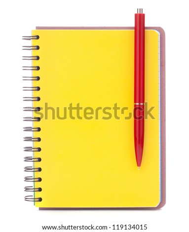 Yellow cover notebook with red pen isolated on white background cutout - stock photo