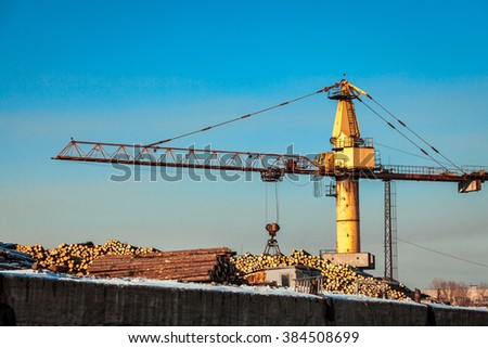 yellow crane at plywood production plant