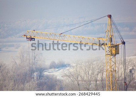 Yellow Crane Tower on the background of a winter - stock photo