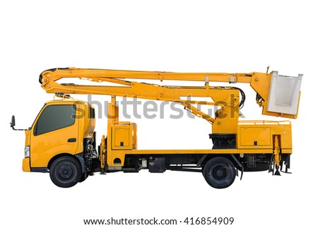 Yellow crane truck for repair high floor,cable car - stock photo