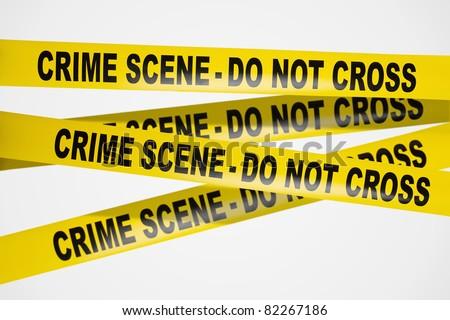 Yellow crime scene tape on white background - stock photo