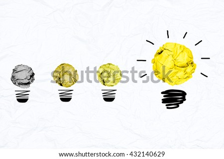yellow crumpled paper light bulb with blue white paper background creative inspiration concept metaphor for change idea  /improve & develop / better answer /step by step/best solution  - stock photo