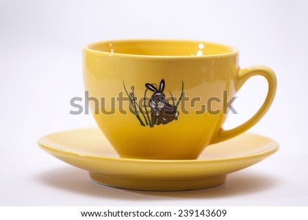 Yellow cup with Easter Bunny theme.