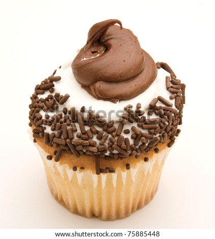 Yellow cupcake covered in chocolate icing and sprinkles against a white background. - stock photo