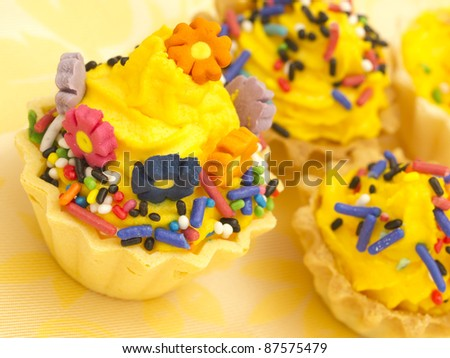 yellow cupcakes - stock photo