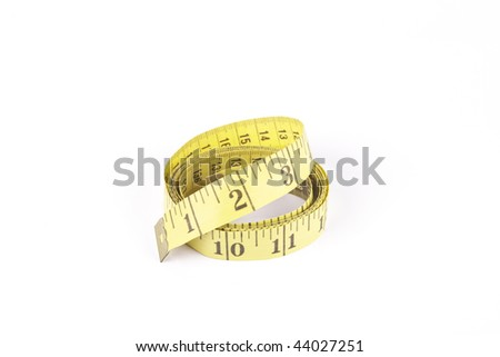 Yellow curled tape measure with a reflective white background