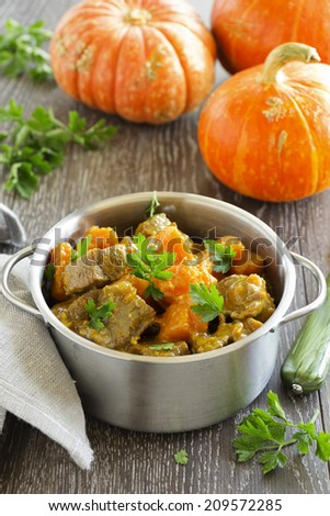 Yellow curry with pumpkin and pork. - stock photo