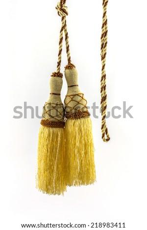 Yellow curtain tassel interior decoration on white background.  - stock photo