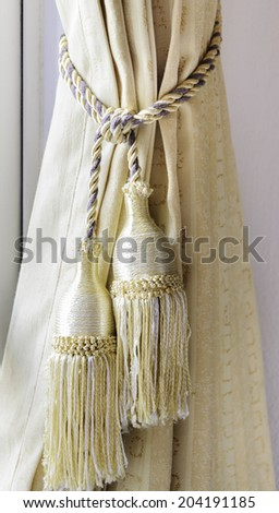 Yellow curtain with an ornament in room - stock photo