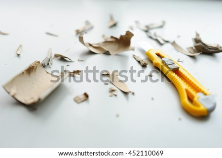 Yellow cutter and piece of paper