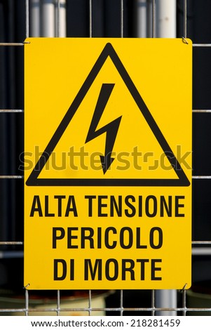 yellow danger high voltage sign in a Italian powerhouse - stock photo