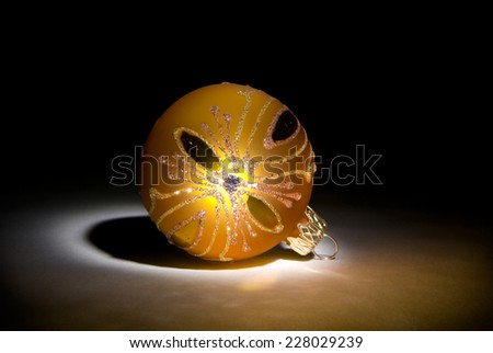 Yellow decorative sphere on a dark art background. - stock photo