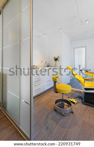 Yellow dental chair in dentist office clinic