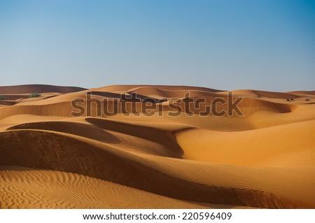 Yellow desert dunes and sky. - stock photo