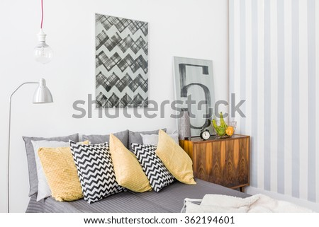 Yellow details in black and white interior