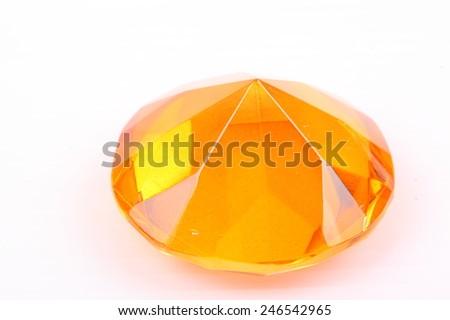 Yellow diamond on a white background - stock photo